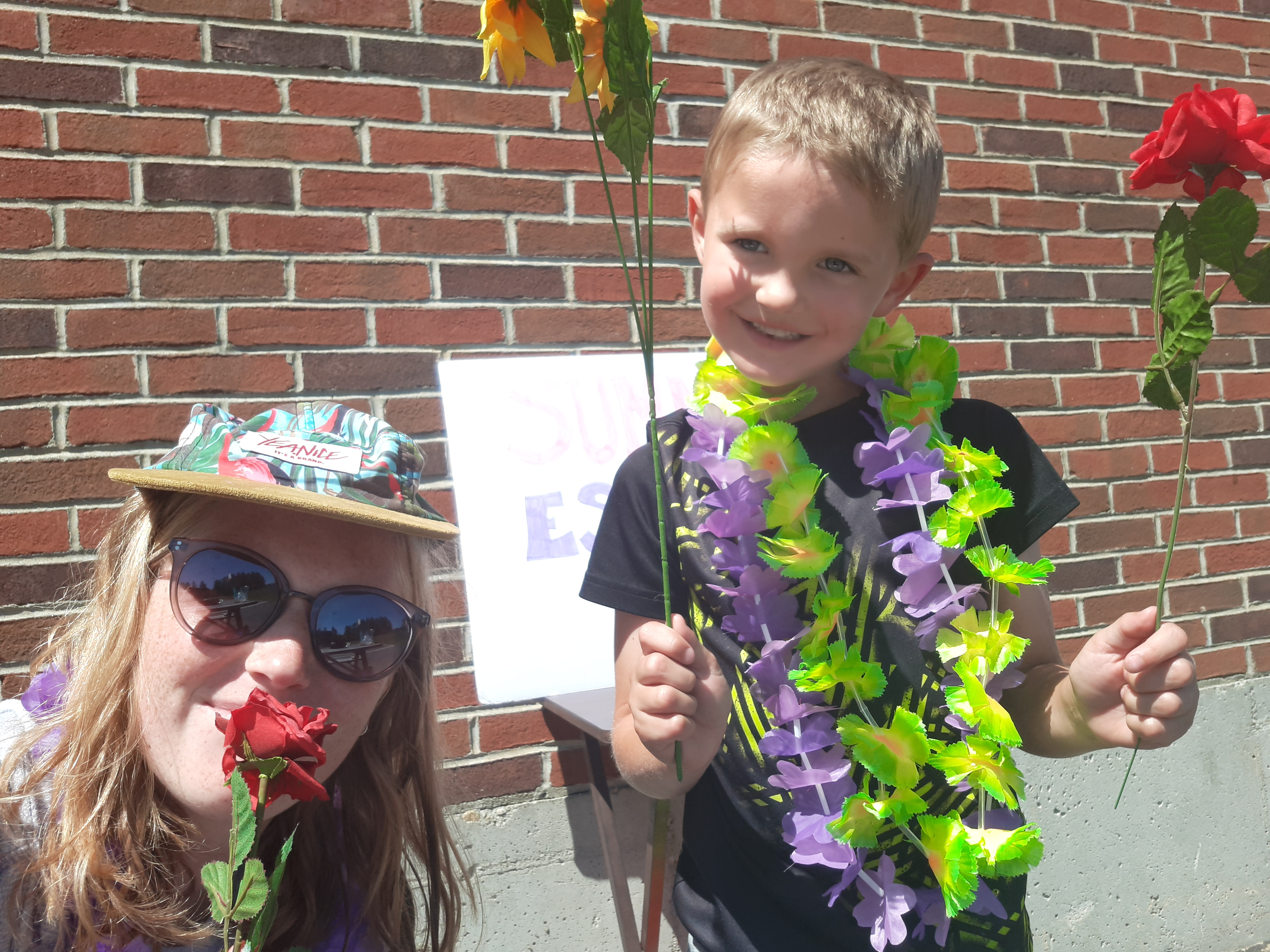 Picture of SummerEscape participant and counselor on carnival day